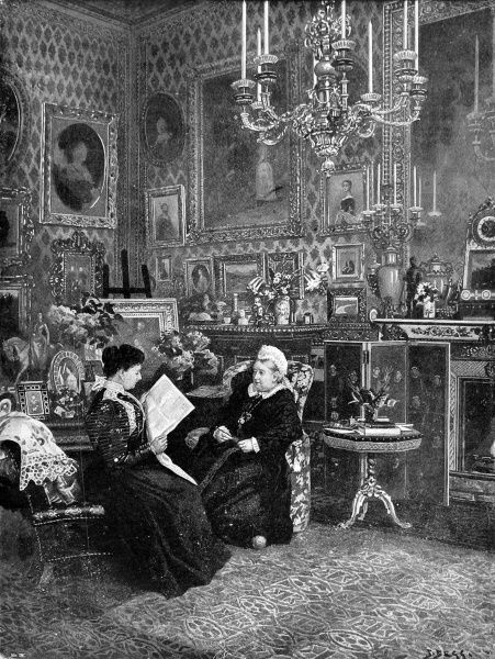 This is a glimpse of the home life of Queen Victoria, seen here sitting in an armchair knitting as she listens to Princess Henry of Battenberg reading from a newspaper