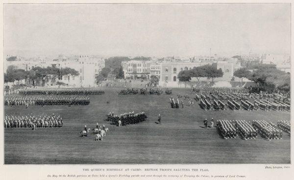 British troops saluting the flag during the Queen's birthday celebrations in Cairo. The British garrison held a birthday parade and went through the ceremony of Trooping the Colour in the presence of Lord Cromer