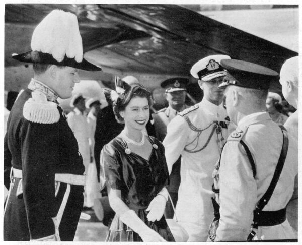 ELIZABETH II The Queen arriving at Entebbe airport near Kampala during a short visit to Uganda in 1954. She is shaking hands with Sir George Erskine