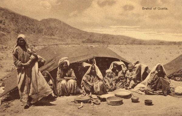 Brahui tribal family and their tent, near Quetta in the Balochistan Province of Pakistan. The Brahuis of the semi-independent Kalat state were among photographer Marrott's most common subjects. Date: circa 1910