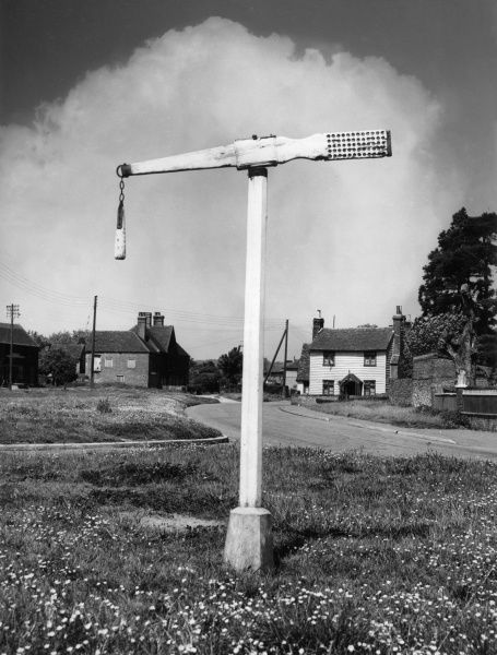 The last surviving QUINTAIN on the village green at Offham, Kent, England. Tilting the quintain was a game played on horseback, with lances aimed at the perforated end. Date: Medieval