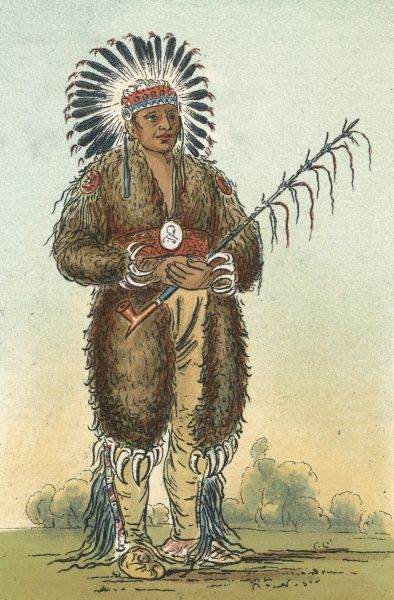 Ottoe warrior with pipe and feathered headdress Date: circa 1830