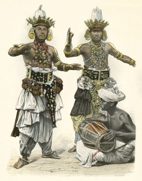 Two Sri Lankan Devil Dancers accompanied by a barrel drum. Their hands are held in detailed positions (mudras) which have symbolic & narative meaning. Date: circa 1890