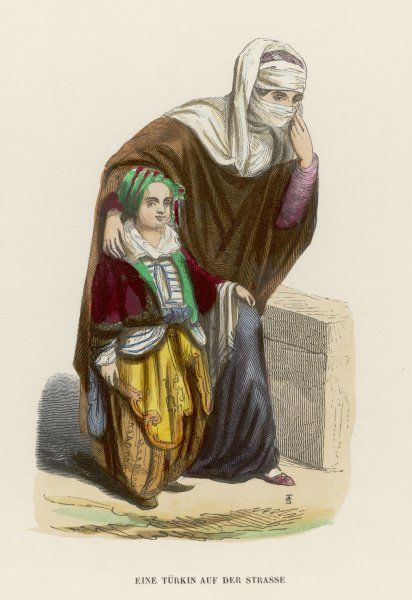 A Turkish woman in street dress, with a little boy