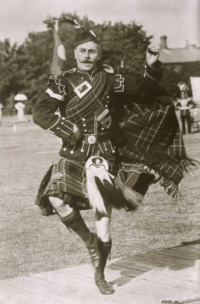 A kilted Scot performs the HIGHLAND FLING
