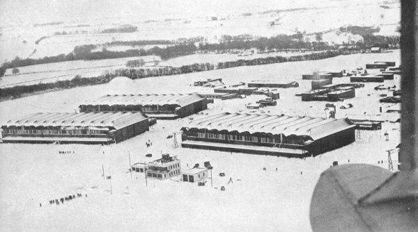 An aerial view of the airfield and aerodrome buildings at Binbrooke, Lincolnshire, as men came out from their huts to pick up the supplies which had been dropped by two Dakotas of Transport Command