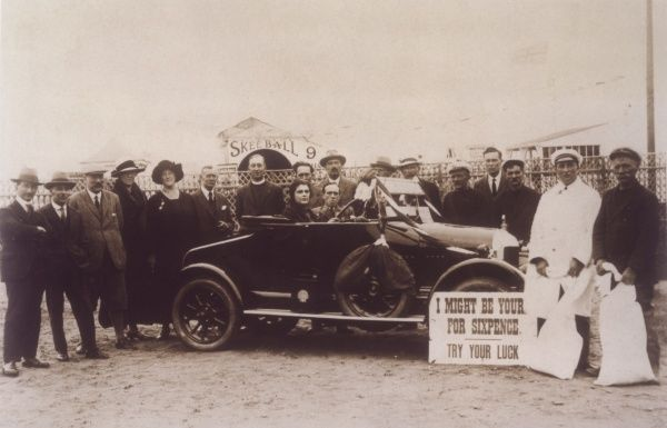 Raffling a Bull-Nose Morris car at Yarmouth Pleasure Beach - 'I might be your's for sixpence. Try your luck&#39