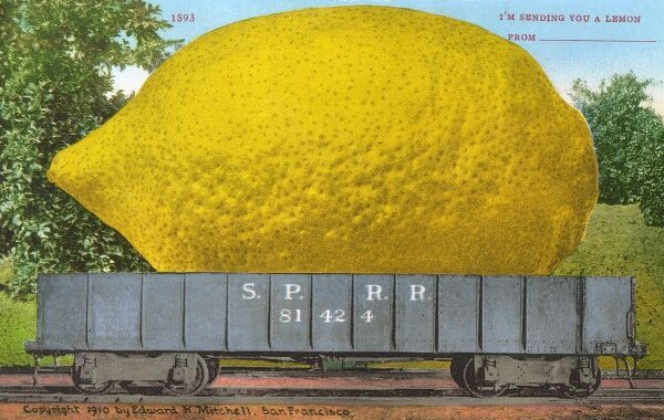 Rail car transporting a giant lemon Date: 1910