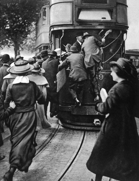 RAIL STRIKE An overcrowded tram on the Thames Embankment, packed with Londoners struggling to get home on a day with no trains or tubes running