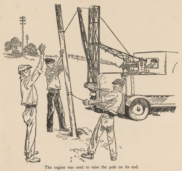 A group of workers erect a telegraph pole with the help of a winch on the back of a truck