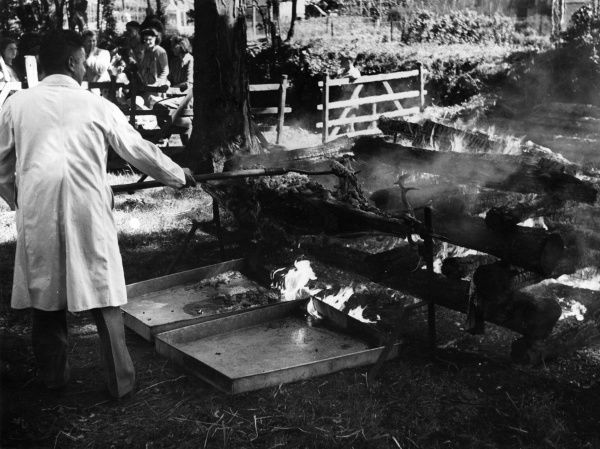 The Ram Roasting Fair at Kingsteington, Devon, England, is an annual (Whit Tuesday) event. A lamb is 'sacrificed' in thanks for rain after a period of drought. Date: circa 1950