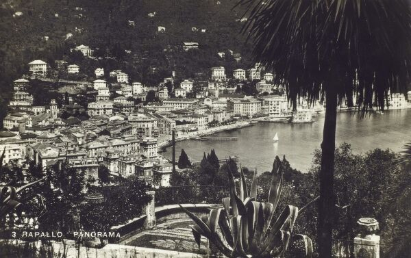 Rapallo, Italy - a municipality in the province of Genoa, in Liguria, northern Italy. Panoramic view looking down toward the bay and waterfront. Date: circa 1940