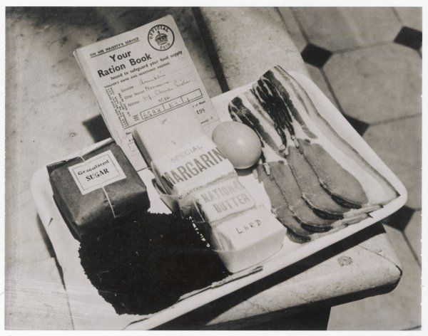 A ration book with rations for a week, including four rashers of bacon, one egg and a quantity of sugar and fat