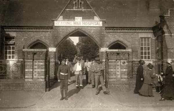 During the First World War, the Reading Union workhouse (opened 1867) on Oxford Road, Reading, Berkshire, was used as a military hospital. A group of convalescing troops, including one black soldier, stand at the hospital entrance. A British soldier