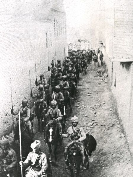 Recapture of Kut Al Amara, Mesopotamia (now Iraq), by Allied troops during the First World War. Showing Indian Cavalry (Lancers) riding along a narrow street. Date: 24 February 1917