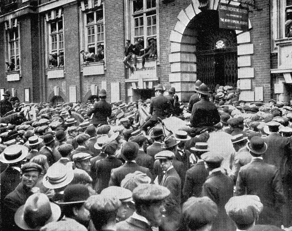 Photograph showing the recruiting offices at Whitehall besieged by crowds of young men hoping to serve King and country, shortly after the outbreak of World War I in 1914. Lord Kitchener made an appeal for 500,000 men to form a second army; 100