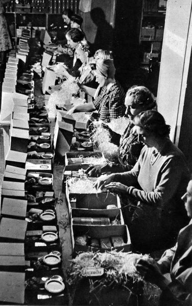Voluntary workers packing some of the 70,000 parcels of food dispatched each week by the Red Cross to the British prisoners of war