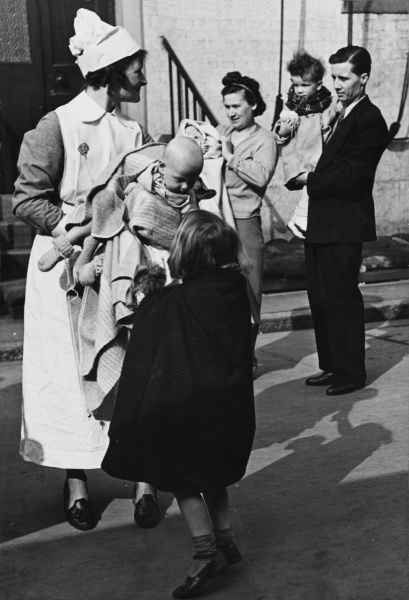At the Fulham Institute, Red Cross nurses look after baby refugees and children during World War II