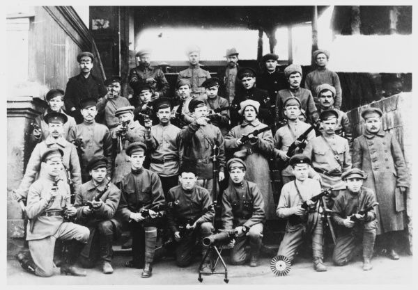 On the eve of the Bolshevik revolution, Red Guards arm themselves with whatever weapons they can lay hands on and pose for a group photo looking ever so determined