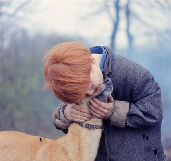 A red-haired gipsy boy with a dog, at an encampment in the Newdigate area of Charlwood, Surrey