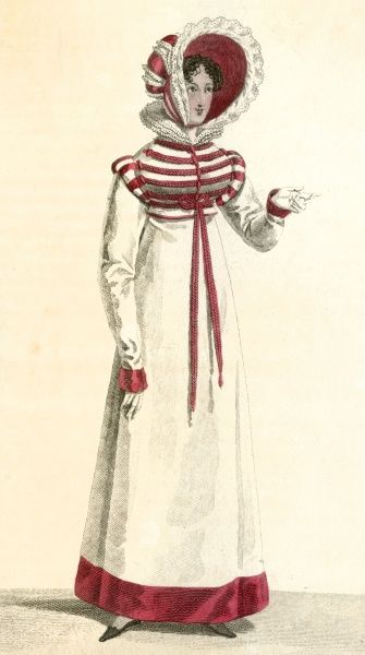 White woollen gown / pelisse with a broad red, velvet band at hem & cuffs & military style Brandenbourg cord trim on the bodice. A large red & white bonnet completes the outfit. Date: 1818