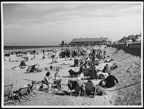 Lots of deckchairs and families with young children on the beach at Redcar, Cleveland, England
