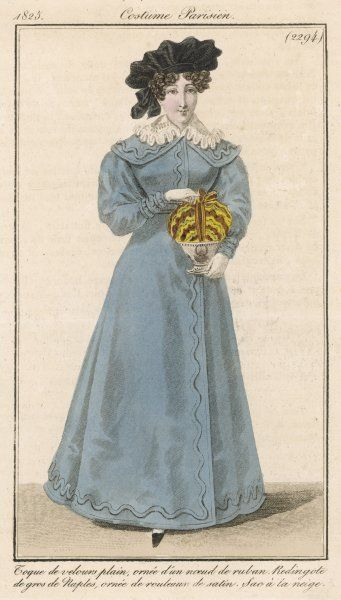 Blue-grey redingote with gigot sleeves & cape collar trimmed with a rouleux attached in a wavy line; also a black velvet toque turban & reticule in imitation of an iced dessert