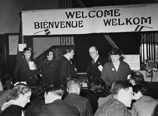 Banner stretches across the platform in the distributing centre to welcome Dutch and Belgian refugees to England during World War II
