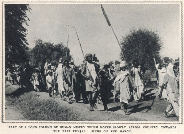 Part of a long column of refugee Sikhs marching across the East Punjab to escape the sectarian religious violence sparked by the partition of India