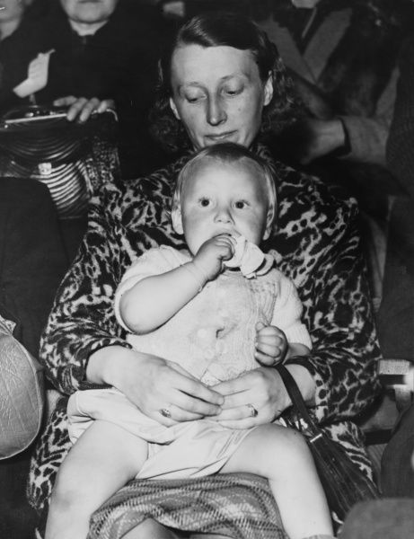 A mother and child awaiting registration, some of the refugees waiting to register and be given billets at the Empire Sports Pool in Wembley, London