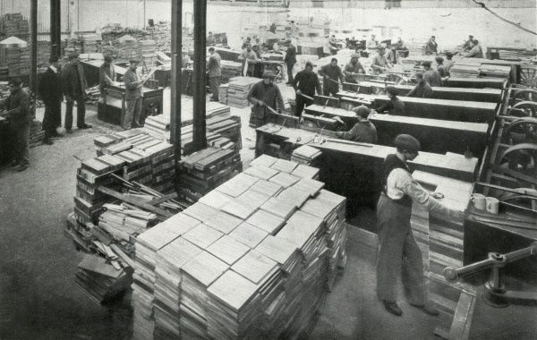 First World War refugees making munitions cases at the 'camp' set up by the Metropolitan Asylums Board at Earl's Court, West London