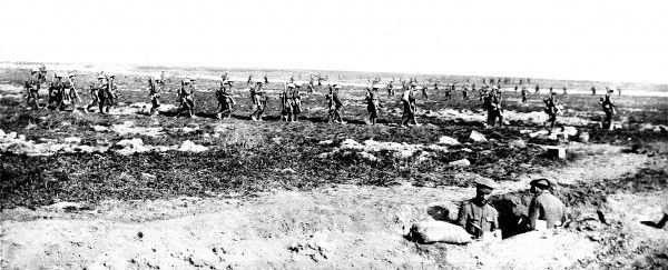 Reinforcements of British infantry are shown moving in long, narrow columns towards the front lines, September 1916. The soldiers marched in such a way to minimise any damage that might be inflicted upon them by enemy artillery fire