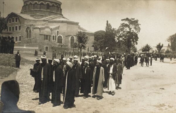 Shiite Muslims in Heliopolis with Egyptian Officials and Dervishes in the background, close to a church. A very interesting scene of a religious gathering