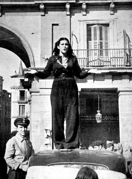 Photograph showing a female Republican supporter giving a speech on top of a car, Madrid, 1936. It was reported that she was calling for more volunteers to join the Republican army