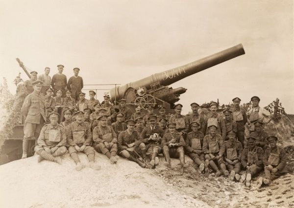 Crew of the RGA (Royal Garrison Artillery) posing for their photo with a 12 inch Howitzer named Bunty, somewhere on the Western Front during the First World War. Date: 1914-1918