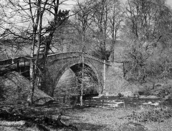 The single span of the Rhyd Llanfair Bridge, over the River Conway, Denbighshire, Wales. Date: 1950s