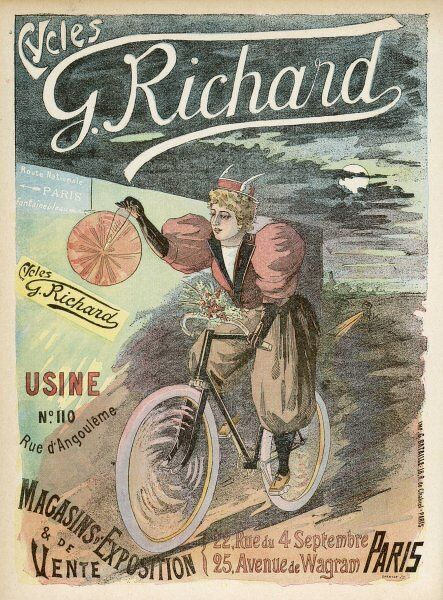 A Parisienne carries a lantern to help her find her way on her Richard bicycle