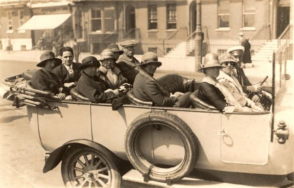 A large tour party taking a ride in a charabanc