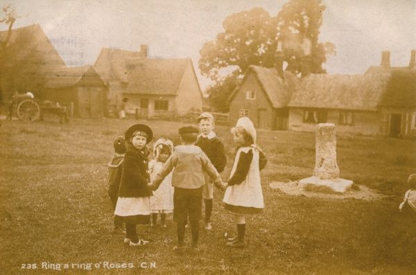 A group of children play the game outdoors in a rural setting