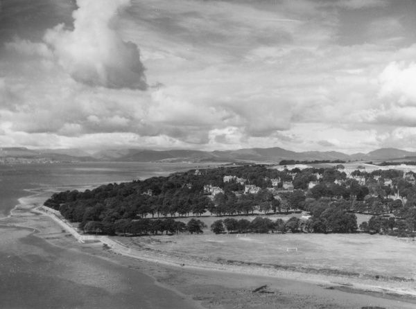 View of the wooded shore of the River Clyde, Dunbartonshire, Scotland, looking westwards from the heights of Dumbarton Rock. Date: 1950s