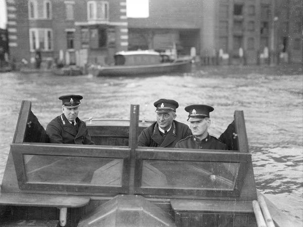 Three members of the River Police in one of the Patrol Boats, probably on the River Thames, London. Date: 1930s
