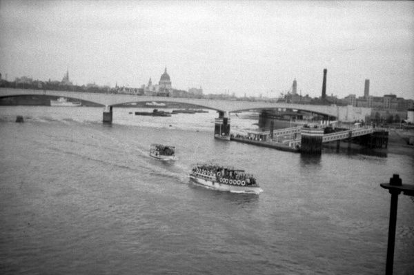 View from Hungerford Bridge towards the City - Festival Hall Pier on right, Waterloo Bridge crossing the Thames and St