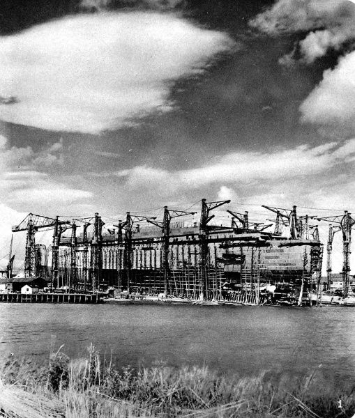 Photograph of the Cunard White Star Liner, R.M.S. 'Queen Mary', under construction at the John Brown shipyard, Clydebank, September 1934. The ship was known as '534' until her launch on 26th September that year