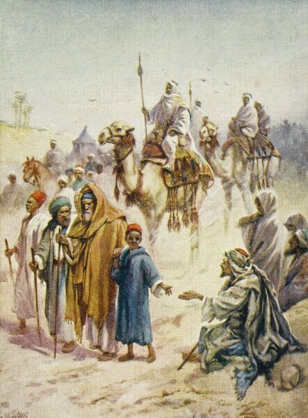 Road to Mecca - Camels and Pilgrims. A beggar sits at the roadside, offered alms by a passing child