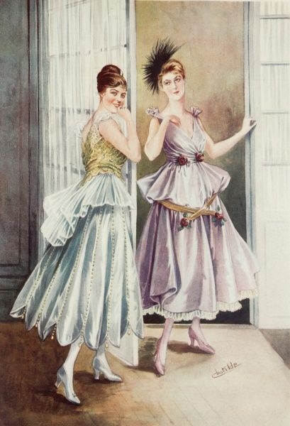 Two flirtatious girls model the latest Parisian dinner gowns with high waists and full, flared skirts typical of the World War One period
