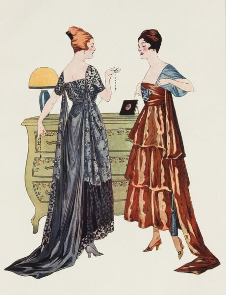 Two models, deep in conversation, show off the latest evening gowns from Paris during the World War One period