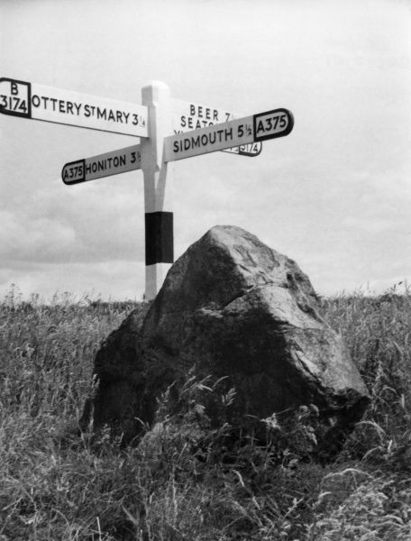 The Rolling Stone, at Putt's Corner, Gittisham, Devon, England. Local folklore says that on a full moon the stone rolls down to the River Sid to wash away sacrificial blood. Date