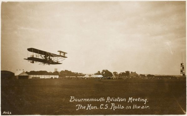 The Honourable Charles Rolls (of Rolls-Royce) flies his Wright biplane at Bournemouth Aviation Week : but he has a fatal crash - Britain's first aviation fatality