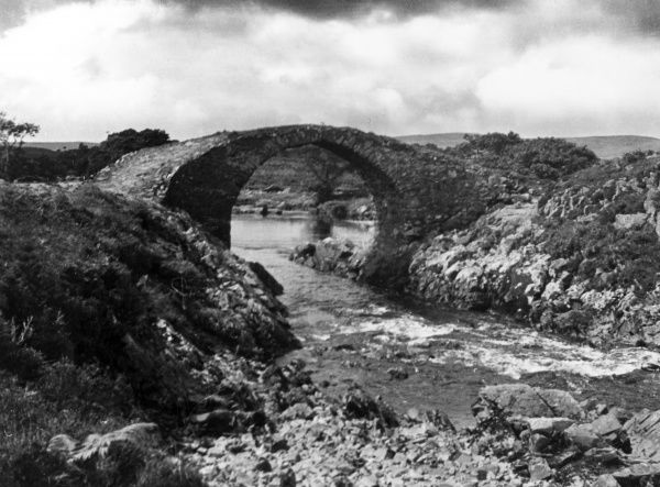 The fine Roman bridge over the River Minnoch, near Newton Stewart, Kirkcudbrightshire, Scotland. Date: 1930s