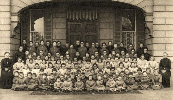 A group picture of children and staff at a Roman Catholic orphanage on Jersey in the British Channel Islands. Date: 1926